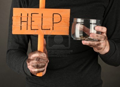15556820-homeless-man-asks-for-help-on-black-background-close-up